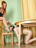 Blond mistress uses a noose around slave's aching balls instead of a leash