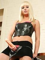 Beautiful mistress tests her new flogger and huge rock-hard strapon on her slave