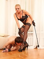 This mature domme will fuck her slave's butt like no man would ever do it