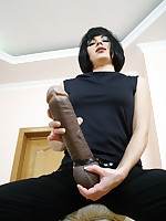 Oversized black strap-on shaft poking in and out of hot boy's hairy shitter