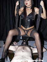Mistress Kiss toys with two males