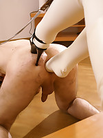 Babe in white latex catsuit fists and foot-fucks her sexy boyfriend's chute